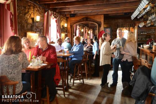 People congregating in tavern area at Olde Bryan Inn eating, drinking and socializing